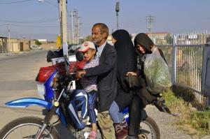 4 auf einem Motorrad